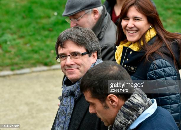Catalonia's ousted regional president Carles Puigdemont walks as he holds his first postelection meeting for members of his parliamentary group in...