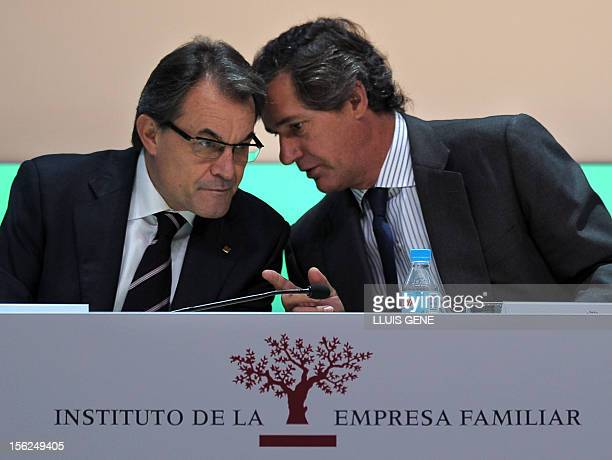 Catalonia's president Artur Mas listens to Jose Manuel Entrecanales president of the Institute for Family Business and Acciona president during the...