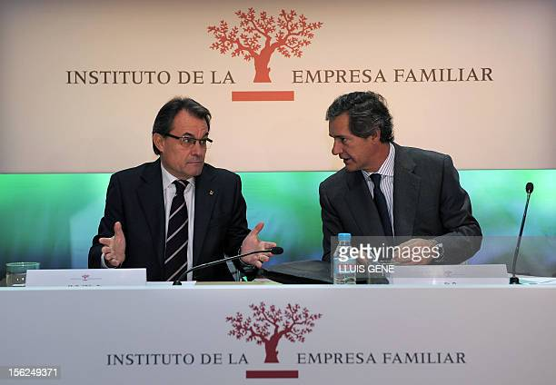 Catalonia's president Artur Mas talks with Jose Manuel Entrecanales president of the Institute for Family Business and Acciona president during the...