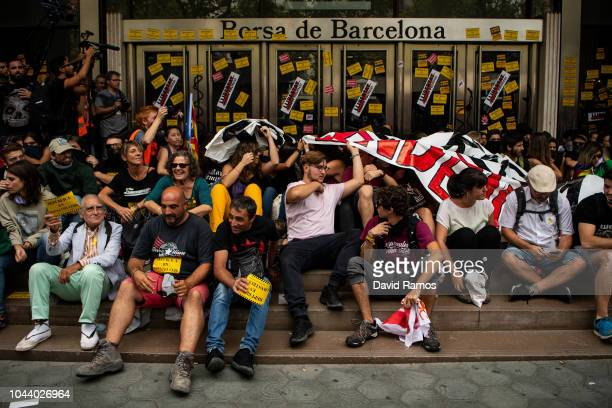 Catalonia's pro independence supporters block the entrance of the Barcelona Stock Exchange during an action to commemorate the first anniversary of...