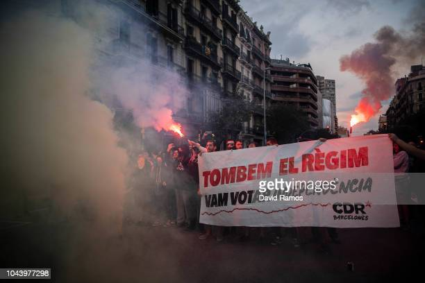 Catalonia's proindependence supporters block a street as they protest during a demonstration to commemorate the first anniversary of the Independence...