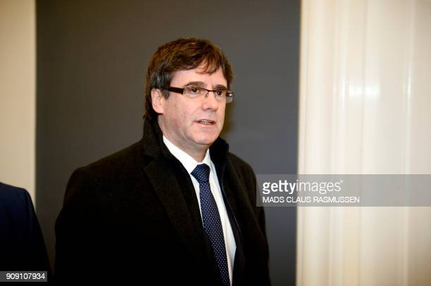 Catalonia's sacked president Carles Puigdemont arrives for a meeting with Danish members of the Parliament on January 23 2018 at Christiansborg...