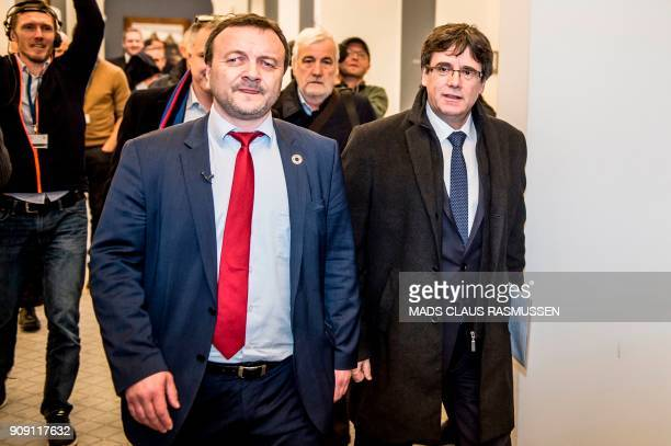 Catalonia's sacked president Carles Puigdemont is welcomed by Danish MP and representative of the Faroese separatist party Tjodveld Magni Arge before...