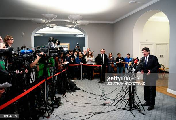 Catalonia's sacked president Carles Puigdemont speaks during a press conference after a meeting with Danish MPs for talks about the Catalan crisis...