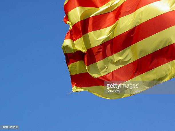 Catalunya flag against blue sky