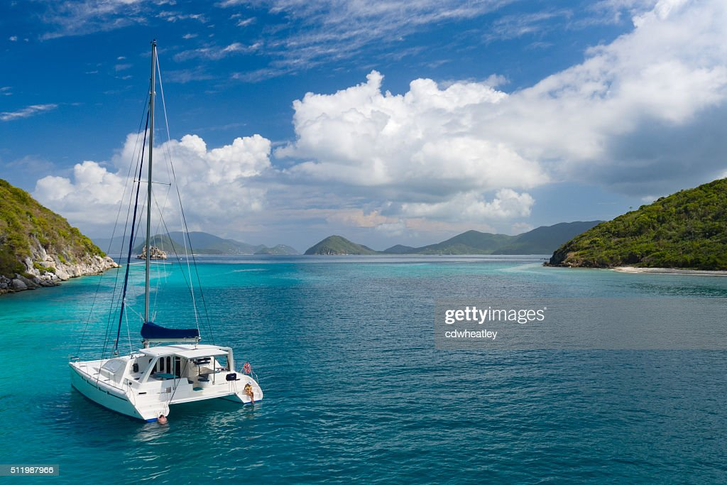 Catamaran anchored by Lovango Cay, US Virgin Islands : Stock Photo