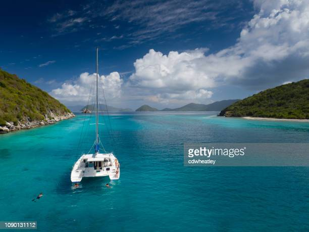 catamaran anchored by lovango cay, virgin islands - catamaran stock photos and pictures