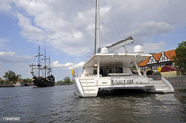 A catamaran glides across the harbour of Poland's historic communistera Gdansk Shipyard on June 22 2011 Polish yachts are making waves reinventing...