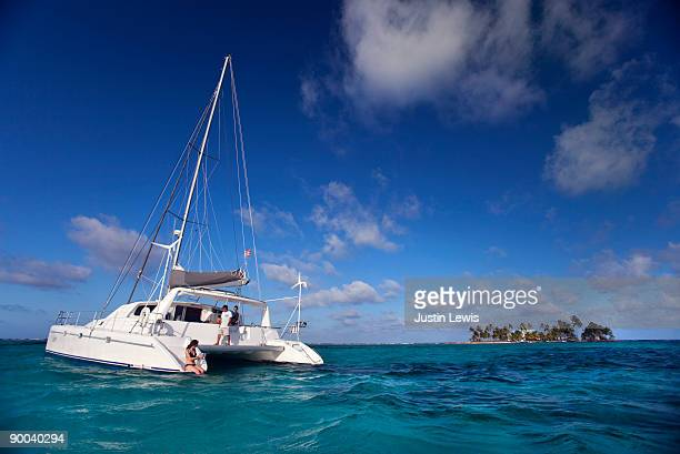 catamaran in caribbean with small island  - catamaran stock photos and pictures