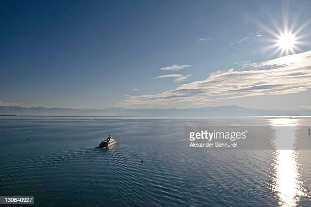 Catamaran leaving the port of Friedrichshafen and travelling to Konstanz, looking towards Romanshorn and the Alpsteinmassiv Massif, Lake Constance, Bodenseekreis district, Baden-Wuerttemberg, Germany, Europe