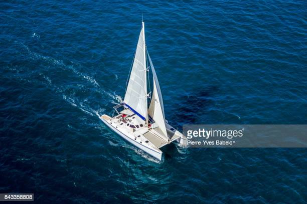 catamaran navigating - catamaran stock photos and pictures