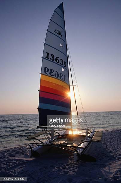 Catamaran on beach at sunset, Emerald Coast, FL, USA