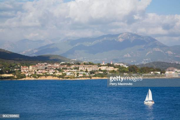 Catamaran on Mediterranean sea and town of Ajaccio, Corsica Island, France