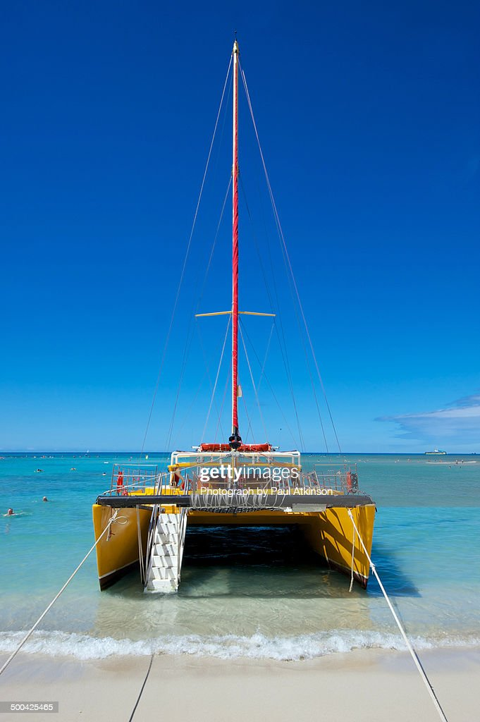 Catamaran On Waikiki Beach Stock Photo