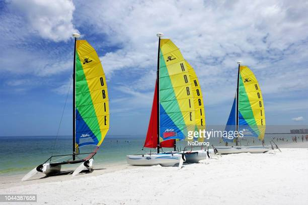 catamaran sailboats on a florida beach - marco island stock pictures, royalty-free photos & images