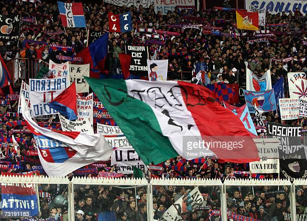 Catania fans show hostility to Palermo fans and police officers during the Serie A match between Palermo and Catania Calcio at Stadio Angelo...
