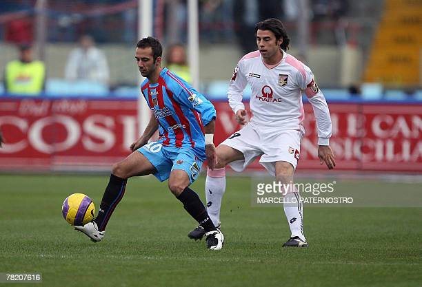 Catania's midfielder Giuseppe Mascara vies with Palermo's defender Andrea Barzagli during their Serie A football match at Massimino Stadium 02...