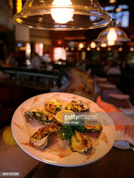 CATaps11022IK Brea October 21Oysters Rockefeller – Oysters baked with a mixture of spinach onions Parmesan and Pernod topped hollandaise– is served...