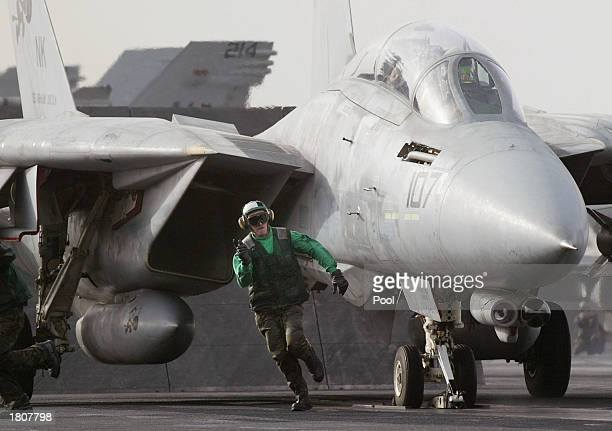 catapult handler runs off as an F14 Tomcat readies to be launched from the USS Abraham Lincoln aircraft carrier February 21 2003 in the Persian Gulf...