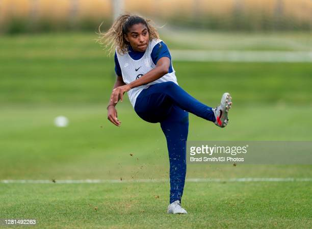 Catarina Macario of the USWNT follows through on a shot during a training session at Dick's Sporting Goods Park training fields on October 20 2020 in...