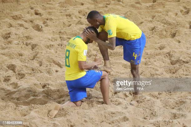 Catarino of Brazil celebrates a goal with team mate Bruno Xavier during the FIFA Beach Soccer World Cup Paraguay 2019 group D match between Brazil...