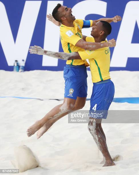 Catarino of Brazil celebrates a goal with team mate Bruno Xavier during the FIFA Beach Soccer World Cup Bahamas 2017 group D match between Braziland...