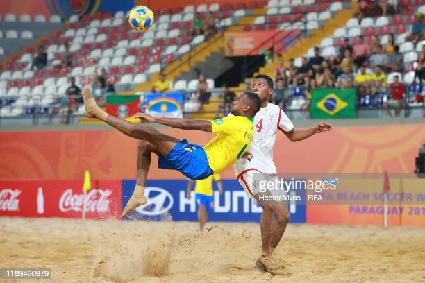 Catarino of Brazil scores a goal against Eid Al Farsi of Oman during the FIFA Beach Soccer World Cup Paraguay 2019 group D match between Brazil and...