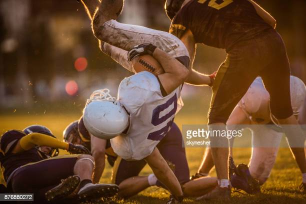 Catch and tackle on American football match!