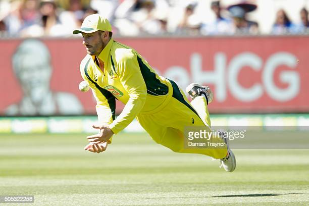 A catch falls just short of Shaun Marsh of Australia during game three of the One Day International Series between Australia and India at Melbourne...