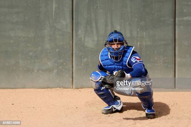Catcher AJ Jimenez of the Texas Rangers in the bullpen during the spring training game against the Kansas City Royals at Surprise Stadium on February...