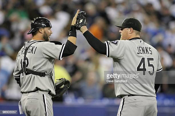 Catcher AJ Pierzynski and pitcher Bobby Jenks of the Chicago White Sox celebrate against the Toronto Blue Jays during their MLB game at the Rogers...