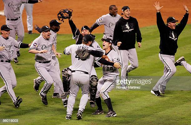 Catcher A.J. Pierzynski hugs pitcher Bobby Jenks as they and the rest of the Chicago White Sox celebrate after winning Game Four of the 2005 Major...