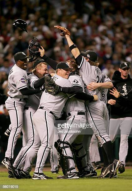 Catcher AJ Pierzynski hugs pitcher Bobby Jenks as they and the rest of the Chicago White Sox celebrate after winning Game Four of the 2005 Major...