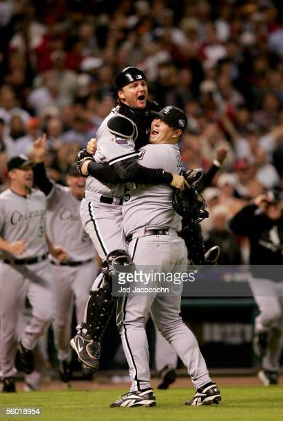 Catcher AJ Pierzynski jumps into the arms of pitcher Bobby Jenks in celebration after winning Game Four of the 2005 Major League Baseball World...