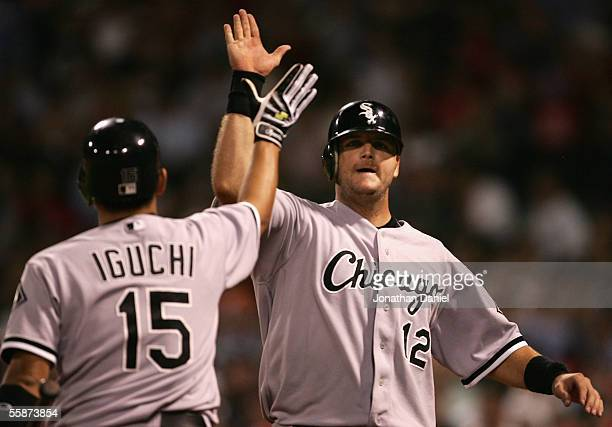 Catcher A.J. Pierzynski of the Chicago White Sox celebrates with teammate Tadahito Iguchi after scoring on a squeeze bunt during the ninth inning of...