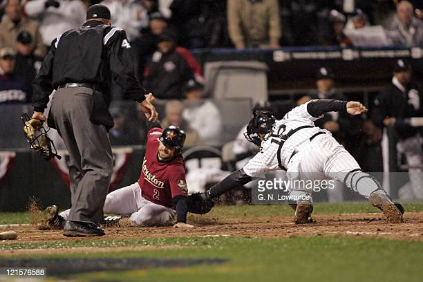 Catcher AJ Pierzynski of the Chicago White Sox misses the tag on Chris Burke on a double by Jose Vizcaino during Game 2 of the 2005 World Series...