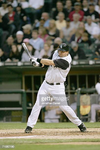 Catcher AJ Pierzynski of the Chicago White Sox swings at an Oakland A's pitch on May 24 2006 at US Cellular Field in Chicago Illinois The White Sox...