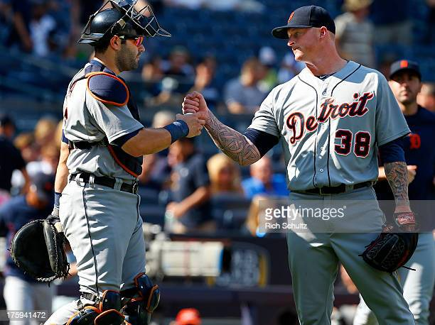 Catcher Alex Avila congratulates pitcher Jeremy Bonderman of the Detroit Tigers after the Tigers defeated the New York Yankees 93 in a MLB baseball...