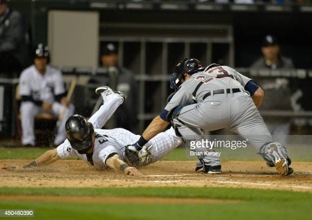 Catcher Alex Avila of the Detroit Tigers tags out Adam Eaton of the Chicago White Sox at home plate after Eaton tried to score from third on a ground...