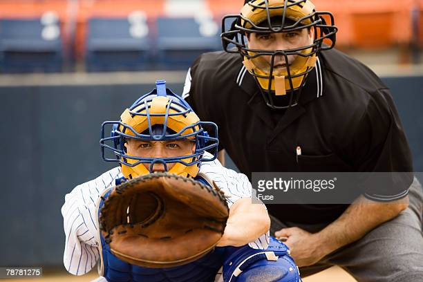 catcher and umpire - baseball catcher stock photos and pictures
