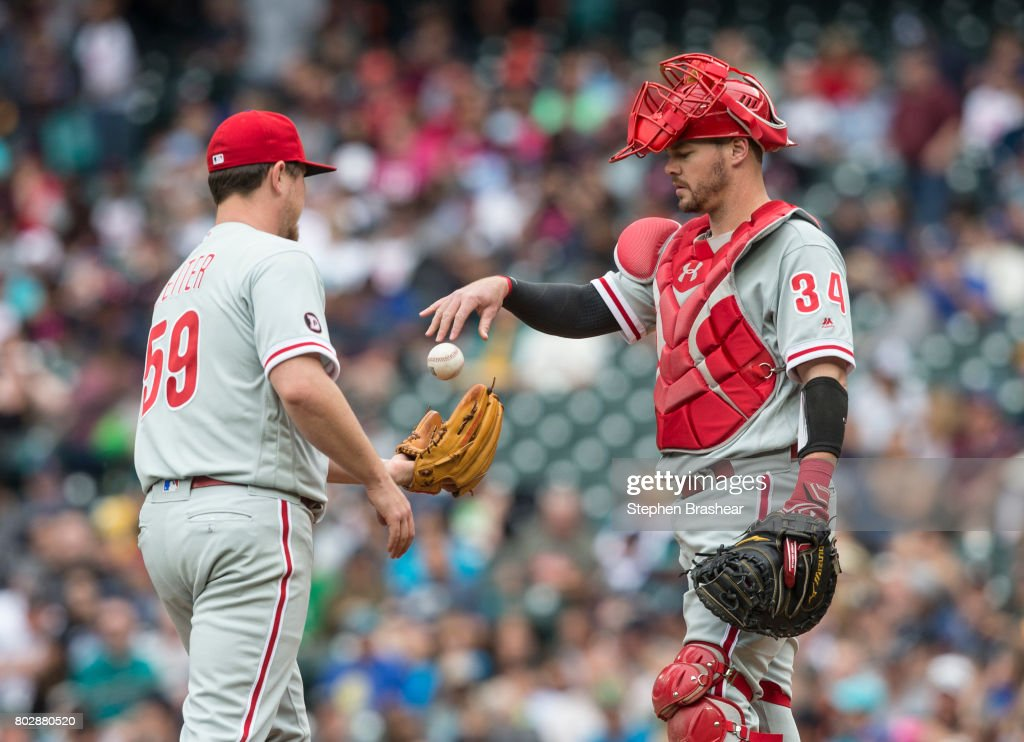 Catcher Andrew Knapp #34 of the Philadelphia Phillies and starting pitcher Mark Leiter Jr. #59 meet at the pitcher's mound during the first inning of an interleague game against the Seattle Mariners at Safeco Field on June 28, 2017 in Seattle, Washington. The Phillies won 5-4.