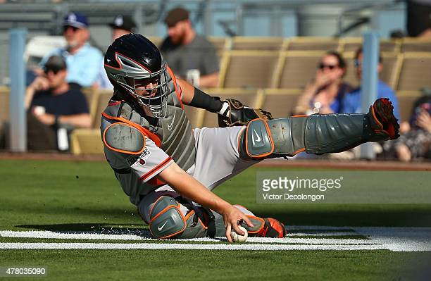 Catcher Andrew Susac of the San Francisco Giants slides behind home plate to grab a wild pitch in the first inning during the MLB game against the...