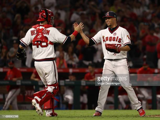 Catcher Anthony Bemboom and closing pitcher Hansel Robles of the Los Angeles Angels celebrate after their 65 victory against the Chicago White Sox in...