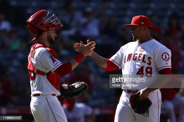 Catcher Anthony Bemboom of the Los Angeles Angels celebrates with closing pitcher Adalberto Mejia after their 92 win against the Chicago White Sox at...