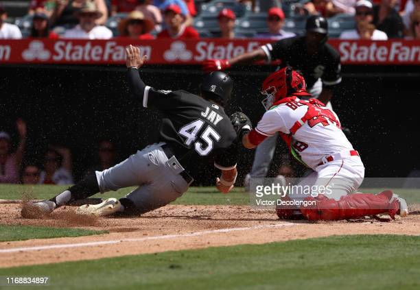Catcher Anthony Bemboom of the Los Angeles Angels puts the tag on Jon Jay of the Chicago White Sox at home plate for the third out in the sixth...