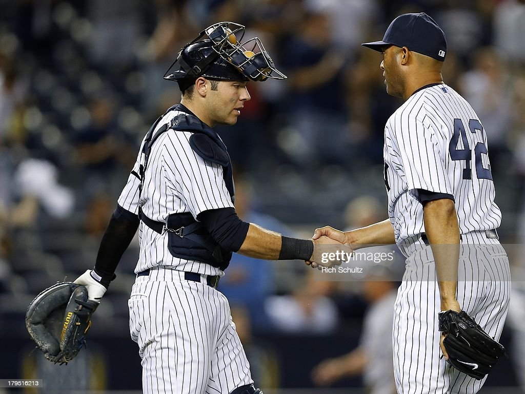 Catcher Austin Romine #53 congratulates closer Mariano Rivera #42 of the New York Yankees after getting a four out save in a 6-5 win over the Chicago White Sox in a MLB baseball game at Yankee Stadium on September 4, 2013 in the Bronx borough of New York City.