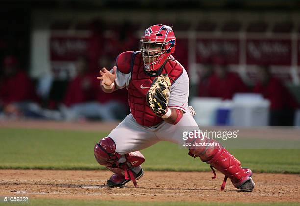 Catcher Bengie Molina of the Anaheim Angels attempts to catch the ball against the Oakland Athletics during the game at the Associates Coliseum on...