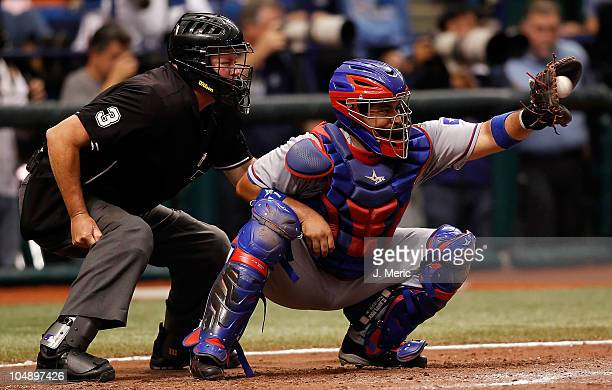 Catcher Bengie Molina of the Texas Rangers catches against the Tampa Bay Rays during Game 1 of the ALDS at Tropicana Field on October 6 2010 in St...