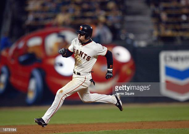 Catcher Benito Santiago of the San Francisco Giants digs for third base during game five of the National League Championship Series against the St...