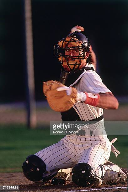Catcher Benito Santiago of theSan Diego Padres catching in spring training in February 1989 in Yuma Arizona Benito Santiago